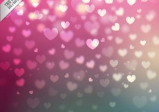 Free vector Hearts background in bokeh style #18739