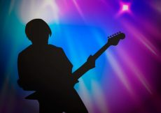 Free vector Blurred background with guitar player silhouette #3978