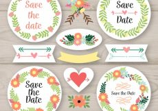 Free vector Colorful pack of wedding labels with floral frame #22479